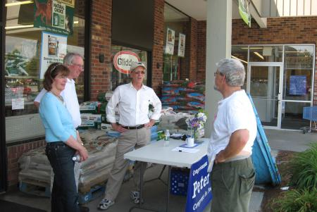 Welch talks to shoppers during a Congress in Your Community event in Milton.